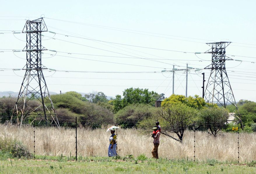 Power-line towers in South Africa belong to Eskom, which is Africa's biggest power utility. It accounts for more than 60 percent of all the electricity generated on the continent, according to the World Bank. It also exports across southern Africa. Critics and even supporters say Eskom should have started its move toward renewable sources of energy earlier, and now needs to set its ambitions higher. (AP Photo/Denis Farrell)