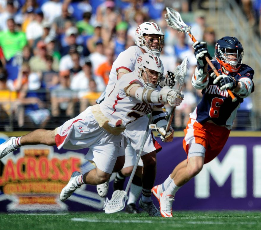 With 260 points, senior attackman Steele Stanwick (right) is Virginia's all-time leader and 21st on the NCAA career scoring list. (Associated Press)