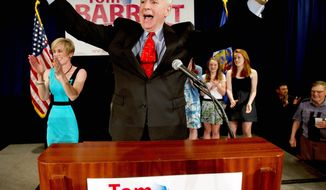 Tom Barrett, Wisconsin's Democratic gubernatorial candidate, celebrates at the party for his primary election victory in Milwaukee on Tuesday. He will face Gov. Scott Walker in a June recall election. (Associated Press)