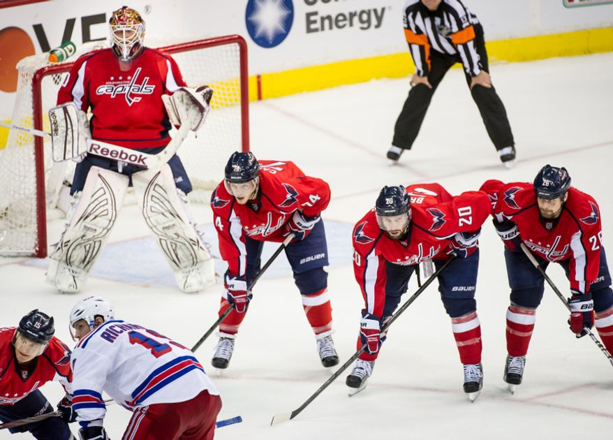 Left to right: Washington Capitals goalie Braden Holtby (70), left, Washington Capitals goalie Braden Holtby (70) Washington Capitals left wing Troy Brouwer (20), and Washington Capitals left wing Matt Hendricks (26) get ready for play to continue in the third period as the Washington Capitals take on the New York Rangers in game six of the NHL eastern conference playoffs semifinals at the Verizon Center, Washington, D.C., Wednesday, May 9, 2012 (Andrew Harnik/The Washington Times)