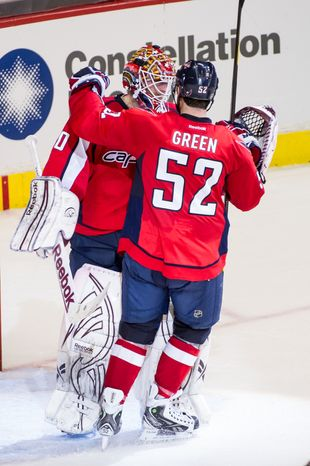 Washington Capitals defenseman Mike Green (52) congratulates Washington Capitals goalie Braden Holtby (70) as they hold on to defeat the New York Rangers 2-1 in game six of the NHL eastern conference playoffs semifinals at the Verizon Center, Washington, D.C., Wednesday, May 9, 2012 (Andrew Harnik/The Washington Times)