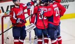 The Washington Capitals congratulate Washington Capitals goalie Braden Holtby (70) as they hold on to defeat the New York Rangers 2-1 in game six of the NHL eastern conference playoffs semifinals at the Verizon Center, Washington, D.C., Wednesday, May 9, 2012 (Andrew Harnik/The Washington Times)