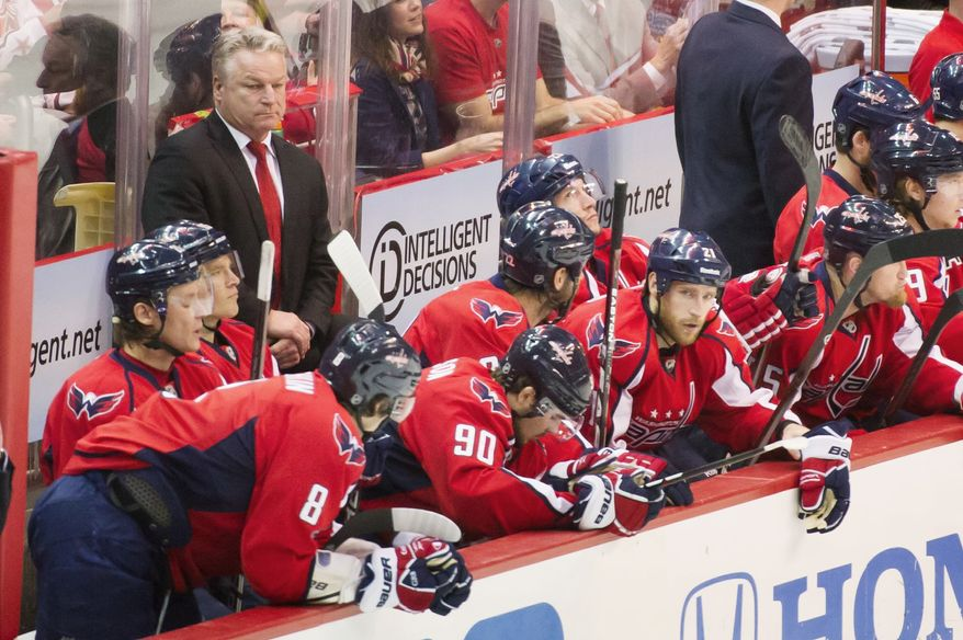 Capitals coach Dale Hunter's demeanor never seems to waver, which his players see as a positive trait when the pressures of the playoffs are greatest. As a player, Hunter brought a fiery temperament to the ice. (Andrew Harnik/The Washington Times)
