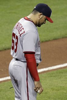 Washington Nationals pitcher Henry Rodriguez walks back to the mound after throwing his second wild pitch of the ninth inning against the Pittsburgh Pirates in Pittsburgh on Tuesday, May 8, 2012. The Pirates won 5-4. (AP Photo/Gene J. Puskar)