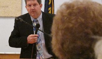 U.S. Postmaster General Patrick Donahoe talks April 12, 2012, to Ingomar, Mont.-area residents about rural post office closures he says are needed as part of cost-cutting moves. (Associated Press)