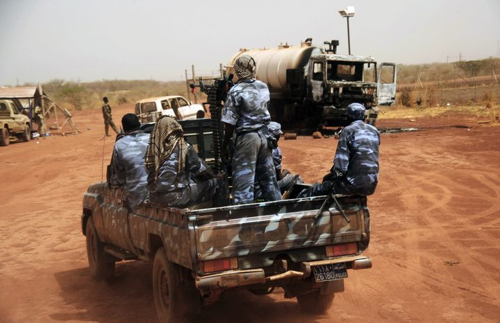 **FILE** Sudanese armed forces ride a military vehicle April 24, 2012, at the oil-rich border town of Heglig, Sudan. (Associated Press)