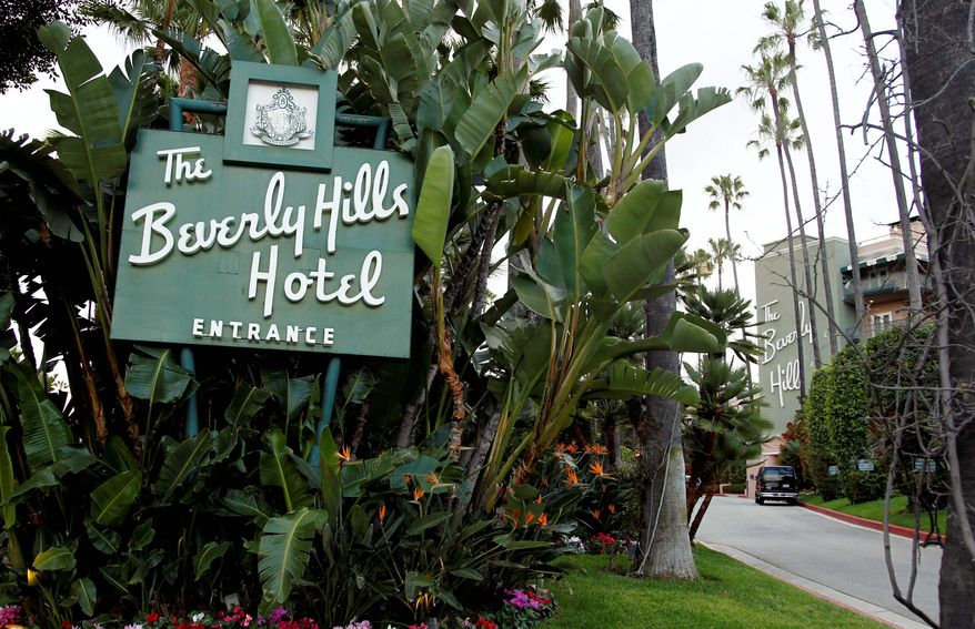 The entrance to the Beverly Hills Hotel is seen in Beverly Hills, Calif. The Beverly Hills Hotel is celebrating its 100th anniversary this year. (AP Photo/Matt Sayles)