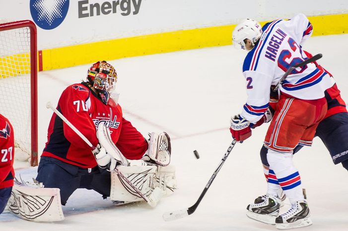 Rookie Braden Holtby, sporting a 1.95 goals-against average and .935 save percentage in the postseason, has been a stalwart for the Capitals. (Andrew Harnik/The Washington TImes)