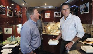 Republican presidential candidate, former Massachusetts Gov. Mitt Romney, talks with chief strategist Stuart Stevens on his campaign bus as they drive from Naples, Fla., to Hialeah, Fla., Sunday, Jan. 29, 2012. (AP Photo/Charles Dharapak)