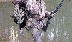"The press is opining that Sen. Rob Portman, Ohio Republican, is a favorite ""insider"" pick as Mitt Romney's vice presidential running mate. Among his outdoorsy interests, Mr. Portman is an avid hunter, and he bagged a turkey during time off from his House duties last month. (Photo provided by Rob Portman)"