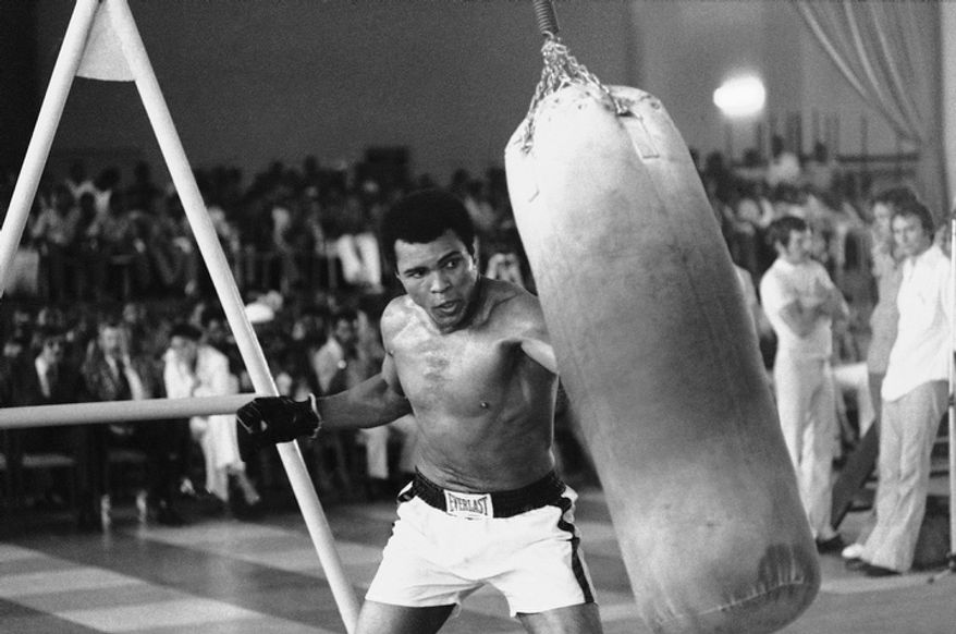 In this October 1974 file photo taken by Associated Press photographer, Muhammad Ali works out before his bout against George Foreman in Zaire.  (AP Photo/Horst Faas, File)