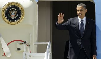 President Obama waves May 10, 2012, upon his arrival in Seattle. Obama was in town for fundraising events. (Associated Press)