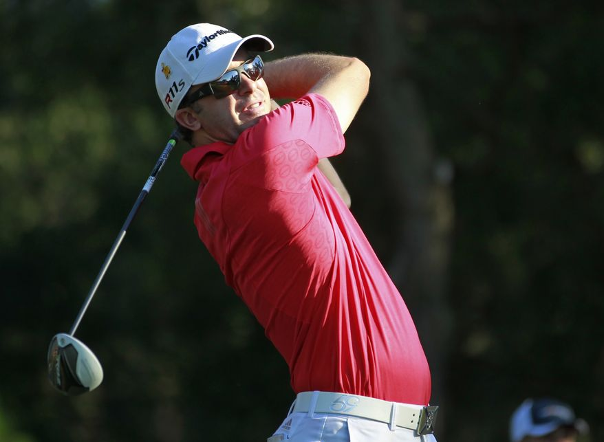 Martin Laird hits from the ninth tee during the first round of the Players Championship on Thursday, May 10, 2012, at Sawgrass in Ponte Vedra Beach, Fla. (AP Photo/John Raoux)