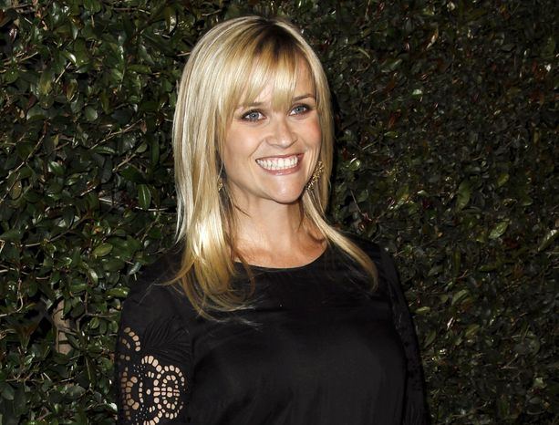 "** FILE ** In this April 13, 2012, file photo, actress Reese Witherspoon arrives at the world premiere of the music video for Paul McCartney's song, ""My Valentine."" (AP Photo/Matt Sayles, file)"
