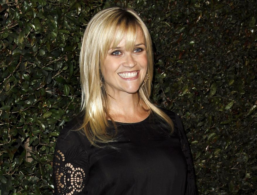 """** FILE ** In this April 13, 2012, file photo, actress Reese Witherspoon arrives at the world premiere of the music video for Paul McCartney's song, """"My Valentine."""" (AP Photo/Matt Sayles, file)"""
