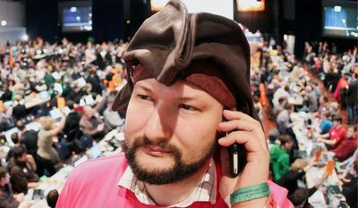 A party member wearing a pirate hat makes a phone call during a meeting of the German Pirate Party in Offenbach, Germany. The party is represented in three German statehouses and is poised to win entry to a fourth in an election on Sunday. (Associated Press)