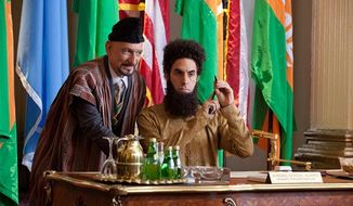 "In this film image released by Paramount Pictures, Ben Kingsley portrays Tamir, left, and Sacha Baron Cohen portrays Admiral General Aladeen in a scene from ""The Dictator."" (AP Photo/Paramount Pictures, Melinda Sue Gordon)"