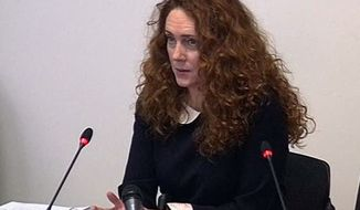 Former News of the World editor Rebekah Brooks gives evidence May 11, 2012, to Britain's media ethics inquiry in central London in this image from television. Brooks is a central figure in the scandal over tabloid phone hacking that has shaken both Rupert Murdoch's News Corp. and Britain's establishment. (Associated Press)