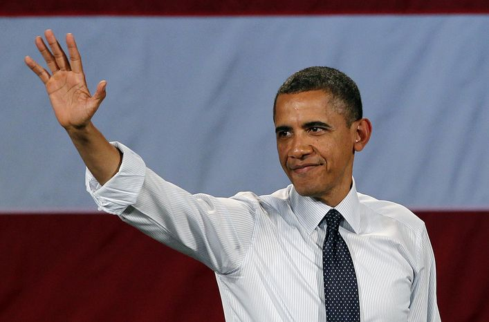 President Obama waves May 10, 2012, as he leaves the stage after speaking at a fundraising event in Seattle. (Associated Press)