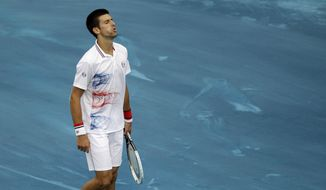 Novak Djokovic reacts after losing a point against Serbian Janko Tipsarevic during a Madrid Open tennis tournament match in Madrid, Spain on Friday, May 11, 2012. (AP Photo/Alberto Di Lolli)
