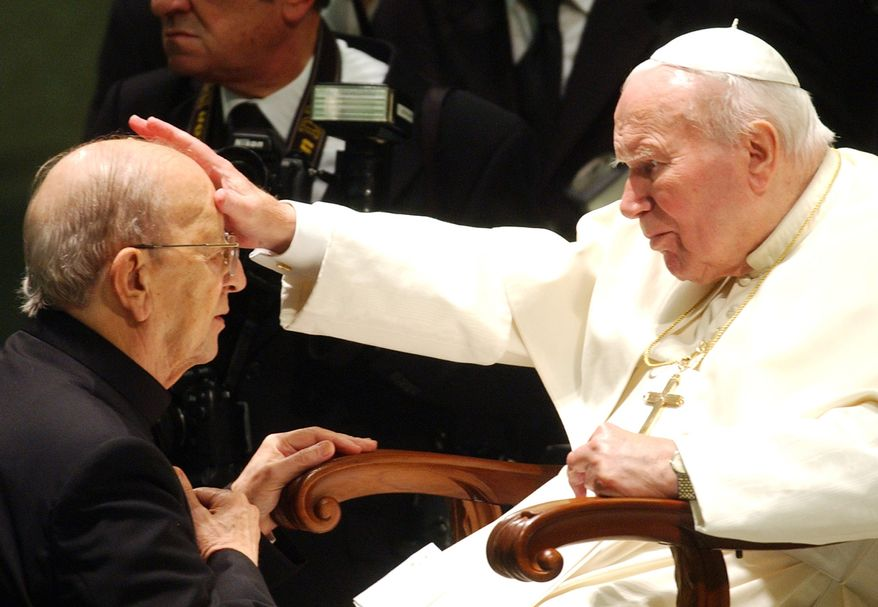 **FILE** Pope John Paul II gives his blessing to father Marcial Maciel, founder of Christ's Legionaries, on Nov. 30, 2004, at the Vatican. (Associated Press)