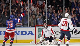 New York Rangers center Brad Richards celebrates Michael del Zotto's game-winning goal in the third period against the Washington Capitals in Game 7 of their second-round series. The Rangers won 2-1 at Madison Square Garden. (AP Photo/Kathy Willens)