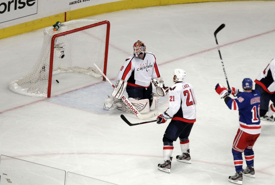 Washington Capitals goalie Braden Holtby (70) and New York Rangers' Marian Gaborik (10) react after a goal by Rangers' Michael Del Zotto during the third period of Game 7 of a second-round NHL hockey Stanley Cup playoff series on Saturday, May 12, 2012, in New York. (AP Photo/Frank Franklin II)