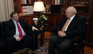 Greek Socialist leader Evangelos Venizelos, left, meets with Greek President Karolos Papoulias in Athens, Saturday, May 12, 2012. (AP Photo/Aris Messinis, Pool)
