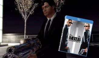 A player controls a Men in Black agent as he battles the Kylothian Serleena in a PS3 video game demo of MIB: Alien Crisis available in the Blu-ray release of Men in Black II.