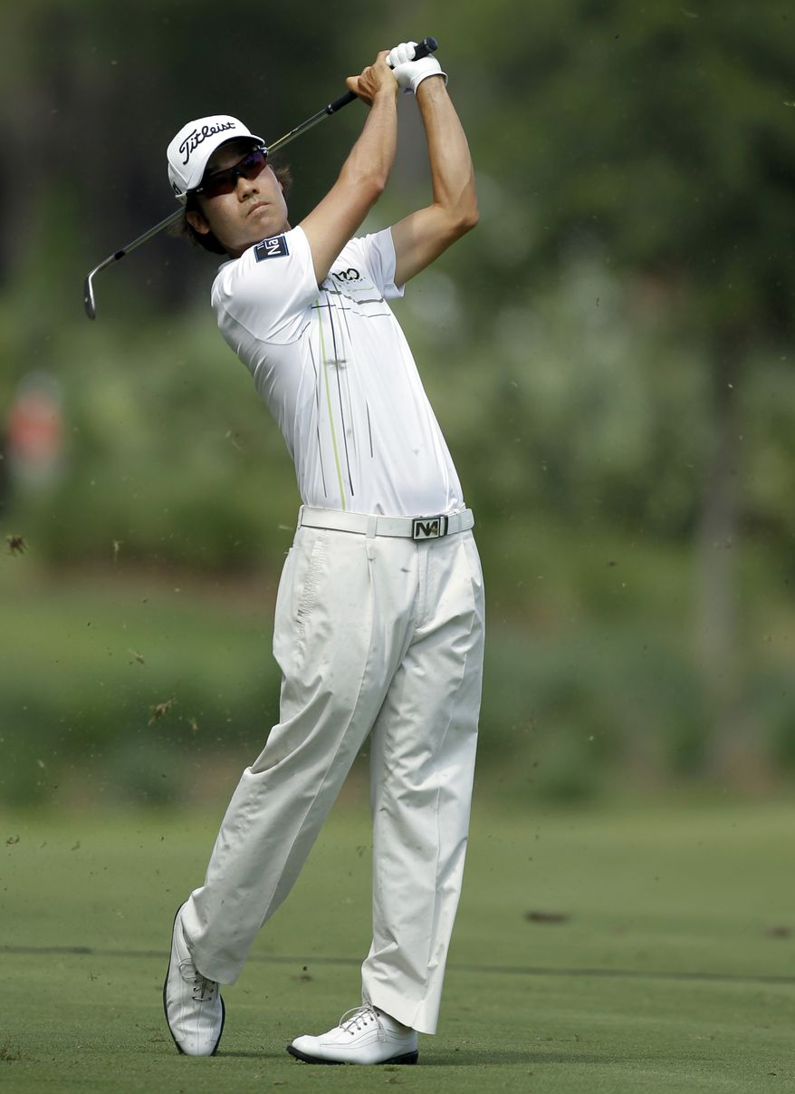 Kevin Na hits from the sixth fairway during the third round of the Players Championship at TPC Sawgrass on Saturday, May 12, 2012, in Ponte Vedra Beach, Fla. (AP Photo/Chris O'Meara)