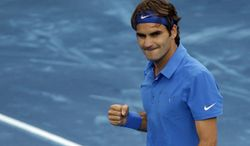 Roger Federer celebrates after defeating Janko Tipsarevic in their Madrid Open semifinal match in Madrid, Spain, on Saturday, May 12, 2012. (AP Photo/Alberto Di Lolli)