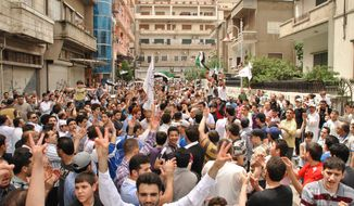 Syrians chant slogans during a demonstration at al-Hamra neighborhood in Homs, Syria, Friday, May 11, 2012. A Syrian opposition leader said Friday the regime is trying to destroy a U.N.-brokered peace plan for the country. (AP Photo)
