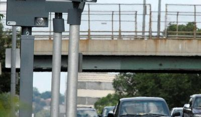 "**FILE** D.C. Mayor Vincent C. Gray's proposal to raise $30 million by expanding a traffic-camera program is a ""ruse"" to take advantage of out-of-state motorists, said AAA Mid-Atlantic spokesman John B. Townsend II. (The Washington Times)"