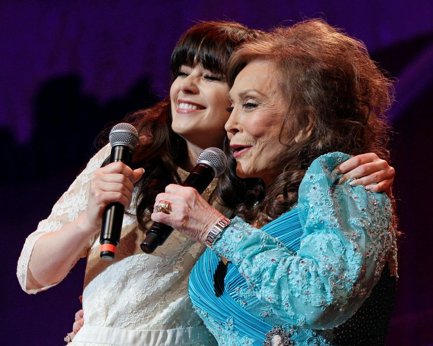"""Country music star Loretta Lynn announced that actress Zooey Deschanel (left) will portray her in a stage version of """"Coal Miner's Daughter."""" (Associated Press)"""