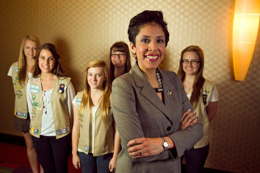 Anna Maria Chavez, chief executive officer of the Girl Scouts of the USA, joins members of Girl Scout Troop 1774, from left, Megan Zimmerman, 17, Molly Gulden, 15, Jessica Krehbiel, 16, Shelby Johnstone, 15, and Lauren McCabe, 16, all of Shadow Mountain High School in Phoenix. Long a lightning rod for conservative criticism, the Girl Scouts of the USA are now facing their highest-level challenge yet: an official inquiry by the U.S. Conference of Catholic Bishops. (Associated Press)
