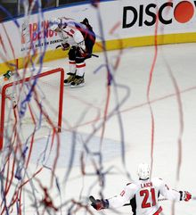 Captain Alex Ovechkin contemplates the Capitals' second-round defeat while Brooks Laich looks on as streamers fall from the rafters at Madison Square Garden on Saturday night. Washington has yet to advance as far as the conference finals in the Ovechkin era. (Associated Press)