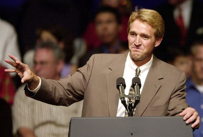 Rep. Jeff Flake, Arizona Republican, campaigns in Phoenix. The six-term congressman seeks re-election as both a Republican primary opponent and Democrats are portraying him as a Washington insider because he worked as a lobbyist 20 years ago for a Namibian uranium operation. (Associated Press)