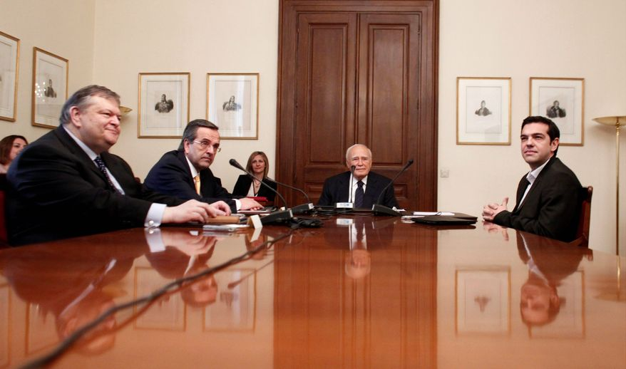 Greek President Karolos Papoulias (center), socialist leader Evangelos Venizelos (first left) conservative leader Antonis Samaras (second left) and leftist leader Alexis Tsipras (right), meet Sunday in Athens. They failed make a deal for a coalition government. A Monday meeting is in doubt because Mr. Tsipras balked at the proposal. (Associated Press)