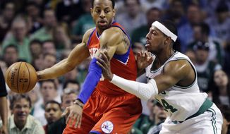 Philadelphia 76ers forward Andre Iguodala, left, posts up on Boston Celtics forward Paul Pierce (34) during the first quarter of Game 1 in the NBA Eastern Conference semifinal playoff series, Saturday, May 12, 2012, in Boston. (AP Photo/Elise Amendola)