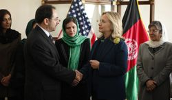 ** FILE ** U.S. Secretary of State Hillary Rodham Clinton (second from right) meets Salahuddin Rabbani during a Civil Society round-table discussion at the U.S. Embassy in Kabul, Afghanistan, on Thursday, Oct. 20, 2011. (AP Photo/Kevin Lamarque, Pool)
