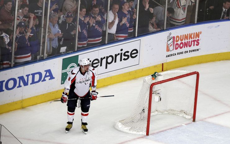 Washington Capitals left wing Alex Ovechkin reacts after his season ended as the Caps lost Game 7 of the second-round series to the New York Rangers, 2-1, on Saturday night. (AP Photo/Frank Frankl
