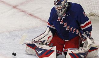 Goalie Henrik Lundqvist made 22 saves as the New York Rangers advanced to the Eastern Conference final with a 2-1 win over the Washington Capitals on Saturday night. (AP Photo/Kathy Willens)