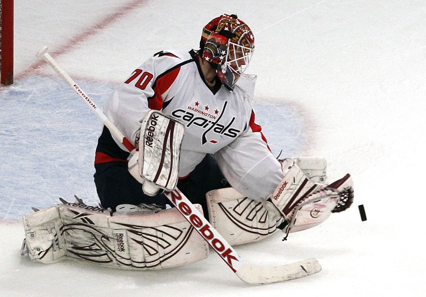 Washington Capitals goalie Braden Holtby (70) makes a save in the second period of Game 7 of a second-round NHL hockey Stanley Cup playoff series against the New York Rangers at Madison Square Garden in New York, Saturday, May 12, 2012. (AP Photo/Kathy Willens)