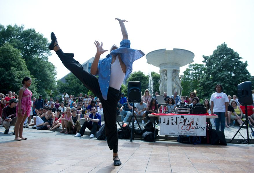 Phillip Fobbs, 16, of Bowie, Md., a senior dance company member with Dance Dimensions in Forestville, Md., peforms on stage at Dupont Circle as part of Dance in the Circle, a dance festival that took place Sunday, May 13, 2012.  (Barbara L. Salisbury/The Washington Times)
