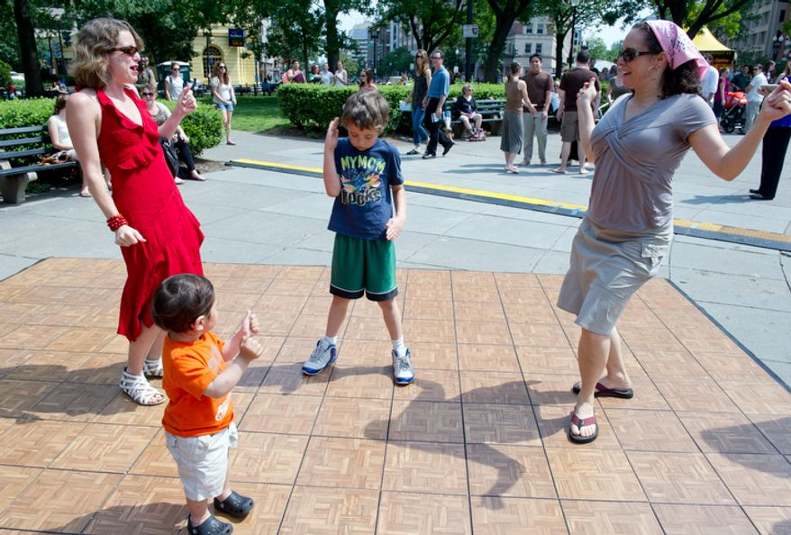 From left, Sara Wright of Washington, D.C., 7-year-old Carson Stadler of Arlington and Carson's mom Kiersten dance along with 18-month-old Karim Bajauri, of Washington, D.C., at the Dance in the Circle, a dance festival for all ages, on Sunday, May 13, 2012 in Dupont Circle. (Barbara L. Salisbury/The Washington Times)