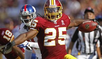 Running back Tim Hightower will be returning to the Washington Redskins for the 2012 season. (Associated Press)