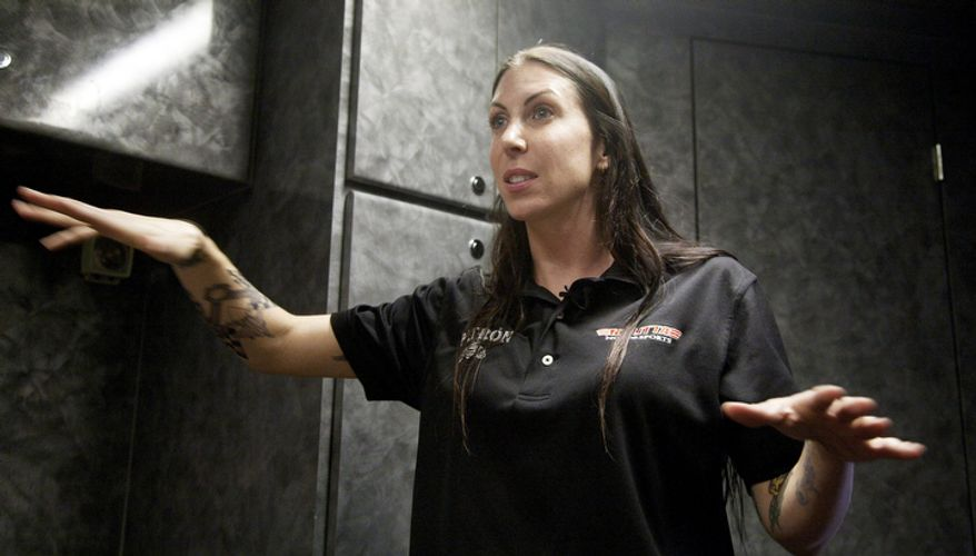 Alexis DeJoria talks about her racing career which began in 2005 when she started drag racing competitively.  (AP Photo/J Pat Carter)
