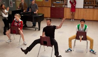 "Ricky Martin (center) guest-stars on ""Glee"" in February with cast members Heather Morris (seated left) and Harry Shum Jr. (seated right). Fox is making a number of changes after the show's viewership dropped 21 percent this season. (Associated Press)"