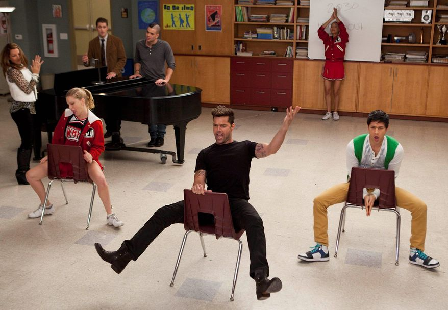 """Ricky Martin (center) guest-stars on """"Glee"""" in February with cast members Heather Morris (seated left) and Harry Shum Jr. (seated right). Fox is making a number of changes after the show's viewership dropped 21 percent this season. (Associated Press)"""