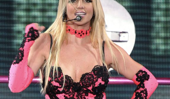 """Britney Spears is joining the judges table on Simon Cowell's """"X Factor."""" She appeared Monday at Fox's presentation about new shows along with Demi Lovato, who also is joining as a judge, plus Mr. Cowell and judge L.A. Reid. (Associated Press)"""